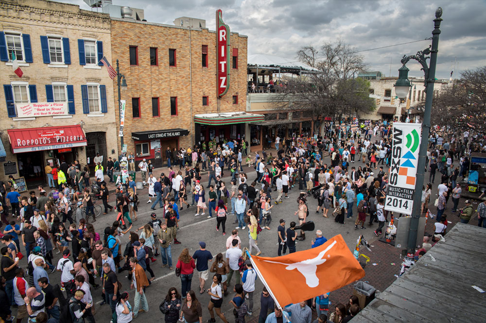 On 6th Street thousands of revelers fill the streets during SXSW