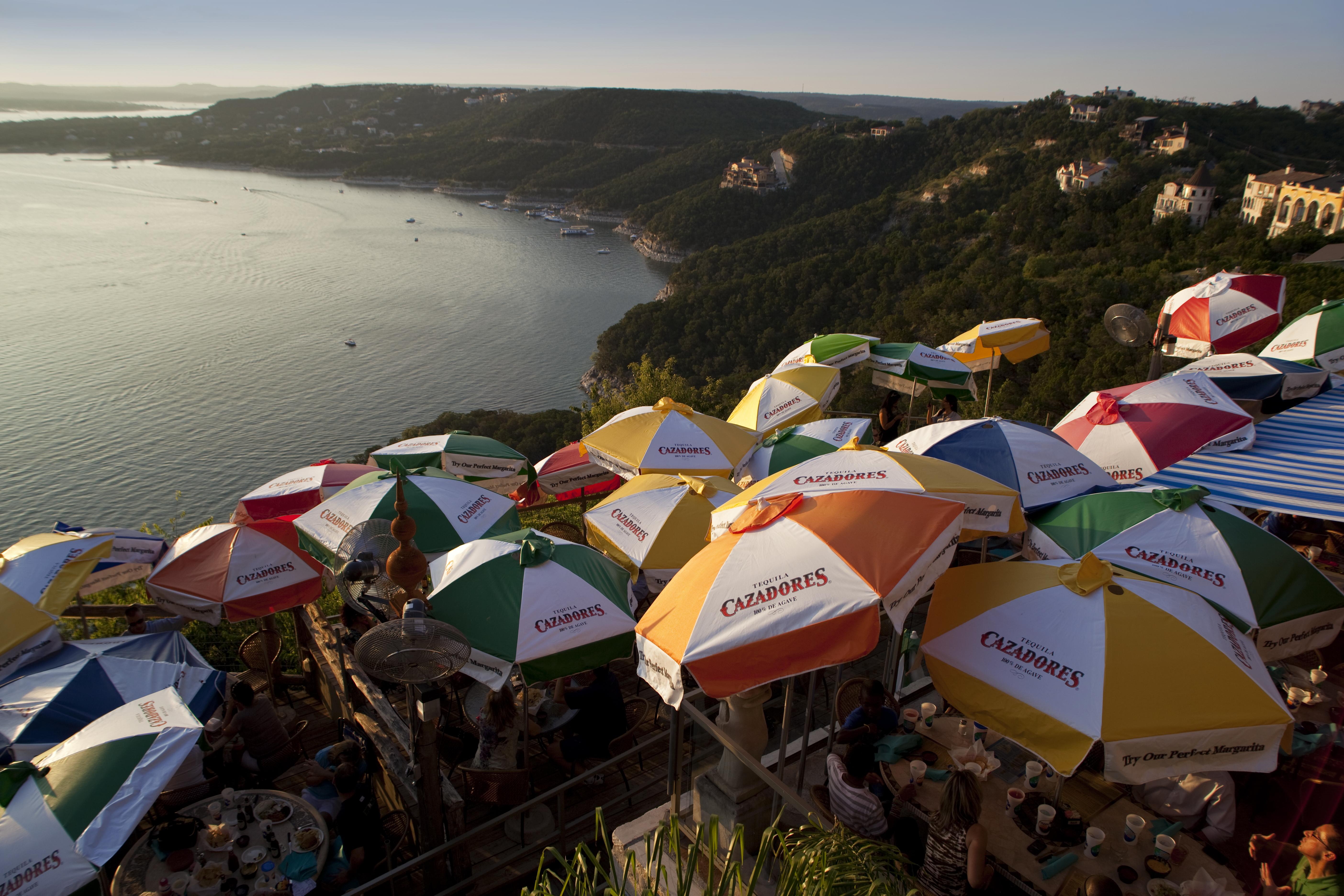 umbrellas line Lake Travis restaurant